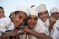 Omani children enjoy watching the Extreme 40s racing, Muscat.